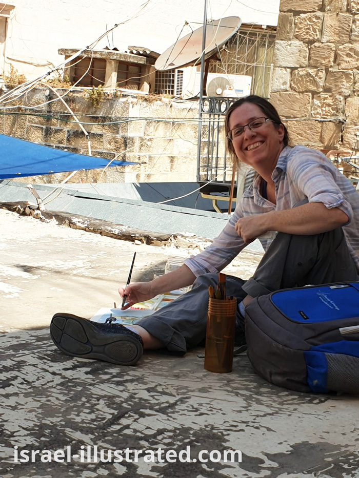 Netta, from Israel Illustrated.com, drawing on the rooftops of Jerusalem