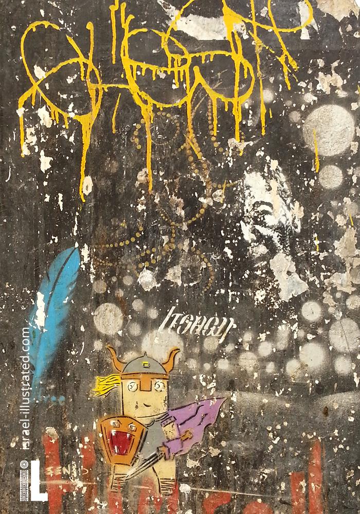 Amazing layers of graffiti, creating a rich grunge texture. Tel Aviv street art with a viking kufson character.