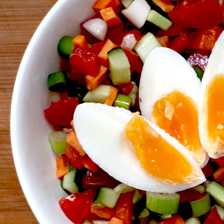 Vegetable salad with hardboiled eggs